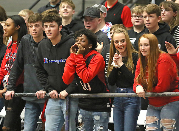 (Brad Davis/The Register-Herald) Greater Beckley students jeer the Woodrow Wilson section across the court Friday night at the Beckley-Raleigh County Convention Center.