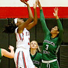 (Brad Davis/The Register-Herald) Oak Hill's Marcayla King drives to the basket as Wyoming East's Daisha Summers defends Thursday night in Oak Hill.
