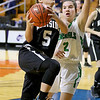 (Brad Davis/The Register-Herald) Westside's Riana Kenneda drives to the basket as Winfield's Emily Bryant defends during Girls State Basketball Tournament action Wednesday afternoon in Charleston.