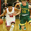 (Brad Davis/The Register-Herald) Oak Hill's Darian McDowell is dogged by pressure from Greenbrier East's Adam Seams Wednesday night in Oak Hill.