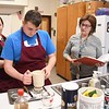 "Linda Shirley, right, baking & pastry and food & nutrition instructor at Woodrow Wilson High School, working with her students, Hannah Shufflebarger and Thomas Stafford, sifting flower to add air and leveling for the proper amount. Senate Bill 297 would require the West Board of Education to create a home economics course for students in secondary school. If passed the class will be called, ""family and consumer science.<br /> (Rick Barbero/The Register-Herald)"