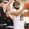 (Brad Davis/The Register-Herald) Greater Beckley's Isaiah Hairston drives to the basket as Trinity's Fletcher Hartsock, left, and Carter Anderson defend Saturday night in prosperity.