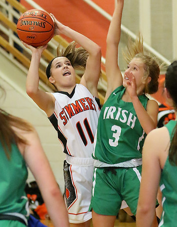(Brad Davis/The Register-Herald) Summers County's Taylor Isaac drives to the basket as Charleston Catholic's Annie Cimino defends Wednesday night in Hinton.