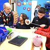 Carl Scrock, left, looks over a STEM project that Summer Burrus, Mason Cook and Jonathan Vermillion are working on in Tonya Sexton's 4th grade class at Shady Spring Elementary School. Scrock donated $20, 000. to the schools STEM program. He was born and grew up in Gray, Pa. and graduated in mining engineering from Penn State University, and he spent some of his life working in mining industry in West Virginia. He's very passionate about STEM education.<br /> (Rick Barbero/The Register-Herald)