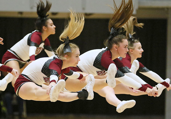 (Brad Davis/The Register-Herald) Woodrow Wilson cheerleaders perform during a break in the action Friday night at the Beckley-Raleigh County Convention Center.