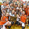 (Brad Davis/The Register-Herald) Summers County players celebrate with the trophy after the Lady Bobcats' win over Charleston Catholic in Region 3 co-final Wednesday night in Hinton.