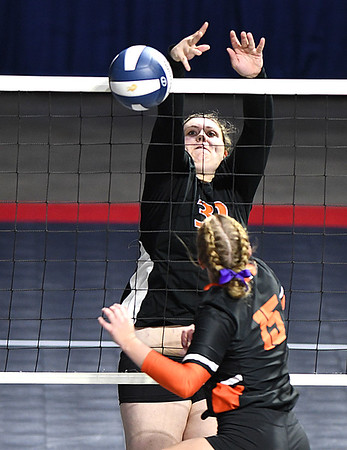 Danielle Midkiff, of Summers Co., blocks a spike hit by, Madison Richards, of Wirt Co., during the semi-final match of the Girls State Volleyball Tournament held at the Charleston Civic Center Wednesday morning. Summers Co. lost 3 sets to 1<br /> (Rick Barbero/The Register-Herald)