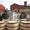 From left, Tag Galyean, John Little, Todd Gunter, Paul Jackson and Travis Hammond examine West Virginia Great Barrel Company barrels Monday in Maxwelton. The first truckload of 53-gallon whiskey barrels made their way from the company and were delivered to Smooth Ambler Spirits Monday. (Jenny Harnish/The Register-Herald)