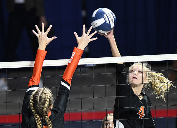 Sullivan Pivot, of Summers Co., right, spikes the ball against, Samantha Burns, of Wirt Co., during the semi-final match of the Girls State Volleyball Tournament held at the Charleston Civic Center Wednesday morning. Summers Co. lost 3 sets to 1<br /> (Rick Barbero/The Register-Herald)