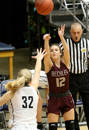 (Brad Davis/The Register-Herald) Woodrow Wilson's Cloey Frantz shoots from three-point range as PikeView's Laken McKinney defends during the New River Community and Technical College Shootout Saturday at the Beckley-Raleigh County Convention Center.