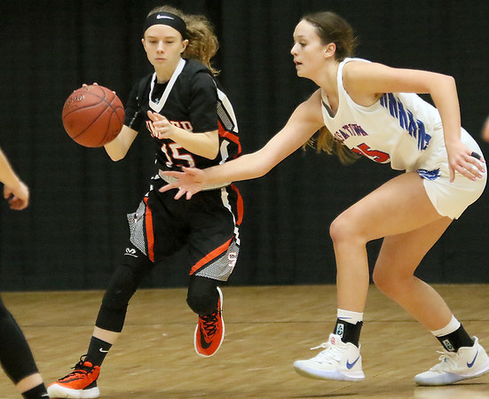 (Brad Davis/The Register-Herald) Summers County's Skylar Angell moves along the perimeter as Morgantown's Kaitlyn Ammons defends during the final day of Big Atlantic Classic action Saturday at the Beckley-Raleigh County Convention Center.