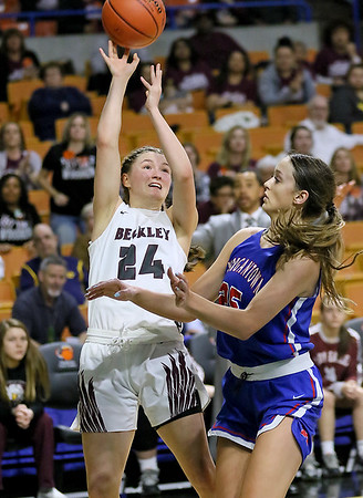 (Brad Davis/The Register-Herald) Woodrow Wilson's Liz Cadle drives and scores as Morgantown's Kaitlyn Ammons defends during  Girls State Basketball Tournament Wednesday afternoon in Charleston.