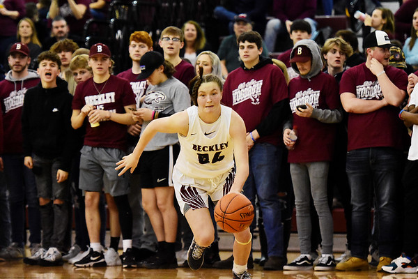 Woodrow Wilson's Liz Cadle races to the basket in front of a standing student section during their Class AAA, Region Conference Final against George Washington  in Beckley on Tuesday. (Chris Jackson/The Register-Herald)