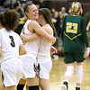 (Brad Davis/The Register-Herald) Woodrow Wilson teammates Olivia Zolkowski, left, and Liz Cadle celebrate after defeating Greenbrier East in a physical battle on their home court Saturday night in Beckley.