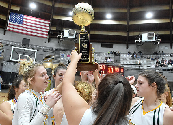(Brad Davis/The Register-Herald) Greenbrier East players celebrate with the trophy after defeating University to win the Class AAA girls championship during the final night of Big Atlantic Classic action Saturday at the Beckley-Raleigh County Convention Center.