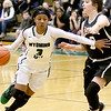 (Brad Davis/The Register-Herald) Wyoming East's Daisha Summers moves along the perimeter as she's pressured by Westside's Hannah Toler Wednesday night in New Richmond.
