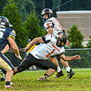Greenbrier West's Ty Nickell, left, defends as Summers County RB fumble's the hand-off for a West recovery during Friday evening action in Charmco. Photo by F. Brian Ferguson
