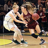 Woodrow Wilson's Cloey Frantz tries to get past Greenbrier East's Kate Perkins during the Class AAA Region 3 Section 2 championship game at Greenbrier East Friday. (Jenny Harnish/The Register-Herald)