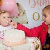 Mila Roop, right, feeds her sister Charlee Roop cake during her first birthday. <br /> (Rick Barbero/The Register-Herald)