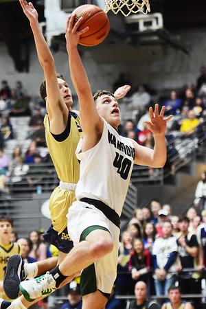 Wyoming East's Jacob Bishop (40) puts up a layup as Shady Spring's Tommy Williams (4) trees to block during their basketball game Thursday in Beckley. (Chris Jackson/The Register-Herald)