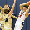 (Brad Davis/The Register-Herald) Independence's Jarred Cannady looks for an open teammate along the perimeter as he's double covered by Greenbrier West's Chase Hagy, left, and Chase McClung Thursday night in Coal City.