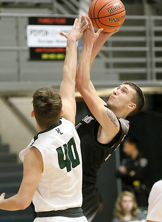 (Brad Davis/The Register-Herald) Westside's Wesley Browning drives and scores as Wyoming East's Jacob Bishop defends during the New River Community and Technical College Shootout Saturday at the Beckley-Raleigh County Convention Center.