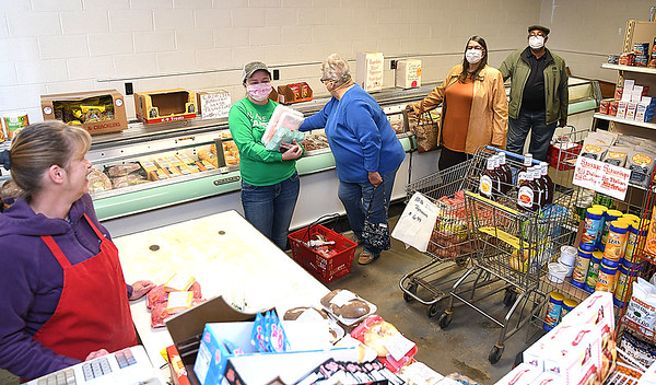 Melissa Kincaid, cashier, left, ringing up purchases  at, Tony's Quality Meats on Toney Ln in Beckley. COVID-19 has caused shortages of meats at supermarkets and shoppers are choosing different avenues for their purchase of meats. <br /> (Rick Barbero/The Register-Herald)