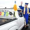 Noam Feamster, waves to classmates during Greenbrier West High School graduation ceremony Friday evening  held at the State Fair of West Virginia's free parking lot in Fairlea. <br /> (Rick Barbero/The Register-Herald)