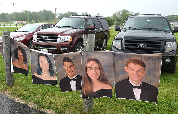 Pictures displayed of seniors of Greenbrier West High School were on display during the graduation ceremony Friday evening held at the State Fair of West Virginia's free parking lot in Fairlea. <br /> (Rick Barbero/The Register-Herald)