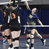 Alyvia Harvey, left, and Danielle Midkiff, of Summers Co., blocks a hit from Meagan Poticher, of Greenbrier West, during the quarter-final match of the Girls State Volleyball Tournament held at the Charleston Civic Center Wednesday morning. Summers Co. won 3 sets to 1<br /> (Rick Barbero/The Register-Herald)