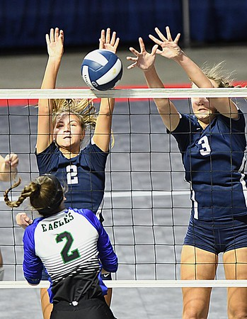 Kelsie Dangerfield, left, and Meg Williams, reaches high to block, Taylor Lough, of Robert C Byrd spike in the semi-final match of the Girl Calss AA State Volleyball Tournament held at the Charleston Civic Center Friday afternoon. Shady won the match 3-1<br /> (Rick Barbero/The Register-Herald)
