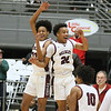 (Brad Davis/The Register-Herald) Woodrow Wilson teammates Keynan Cook, left, and Richard Law celebrate after the Flying Eagles defeated the Princeton Tigers for Class AAA, Region 3, Section 2 Championship Friday night at the Beckley-Raleigh County Convention Center.