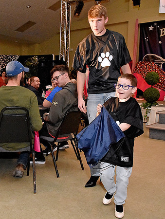 """(Brad Davis/The Register-Herald) Jayden Straughn and Maverick Davis set out to meet the crowd during the 2020 Hunks in Heels """"Fur"""" Real fundraising event at the Beckley Moose Lodge."""