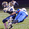 Shady Spring's Josh Goode attempts to break the tackle of Midland Trail's Robert Ruffner during Friday evening action at Shady Spring. F. Brian Ferguson