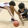 (Brad Davis/The Register-Herald) Princeton's Peyton Brown dives for a loose ball with Woodrow Wilson's Bryant Jones during the Class AAA, Region 3, Section 2 championship game Friday night at the Beckley-Raleigh County Convention Center.