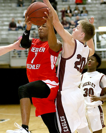 (Brad Davis/The Register-Herald) Greater Beckley's Elijah Edwards drives to the basket as Woodrow Wilson's Ayden Ince defends Friday night at the Beckley-Raleigh County Convention Center.