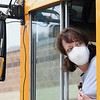Mary Wykle, Wyoming County bus driver, getting ready to pull out of with meals at Westside High School in Wyoming County for students because of the coronavirus crisis.<br /> (Rick Barbero/The Register-Herald)