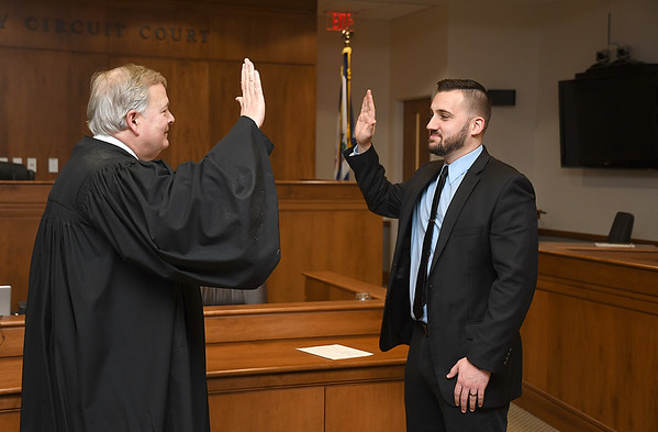 Raleigh County Circuit Judge H.L. Kirkpatrick, swears in Joshua Thompson as the new assistant proscuting attorney.<br /> (Rick Barbero/The Register-Herald)