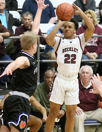(Brad Davis/The Register-Herald) Woodrow Wilson's Richard Law shoots for three from the corner as Princeton's Grant Cochran defends during the Class AAA, Region 3, Section 2 Championship Friday night at the Beckley-Raleigh County Convention Center.