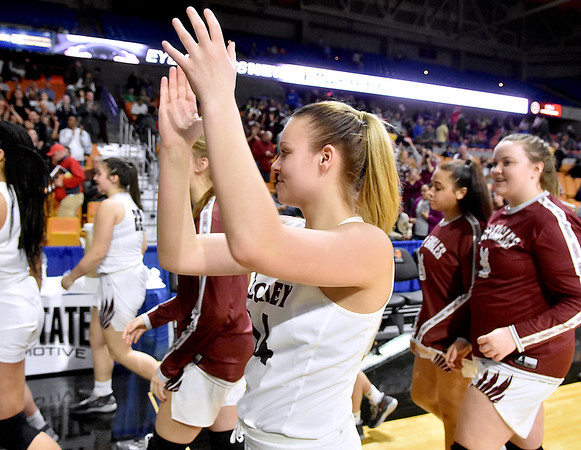 (Brad Davis/The Register-Herald) Woodrow Wilson's Olivia Ziolkowski applauds towards fans and family in the stands after the Lady Flying Eagles defeated Morgantown to advance in the Girls State Basketball Tournament Wednesday afternoon in Charleston.