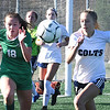Palmer Brown, of Charleston Catholic, left and Gracie Miller, of Phillip Barbour, going after the ball during the semi-final match of the girls state soccer tournament held at Paul Cline Memorial Sports Complex in Beckley Friday morning.<br /> (Rick Barbero/The Register-Herald)