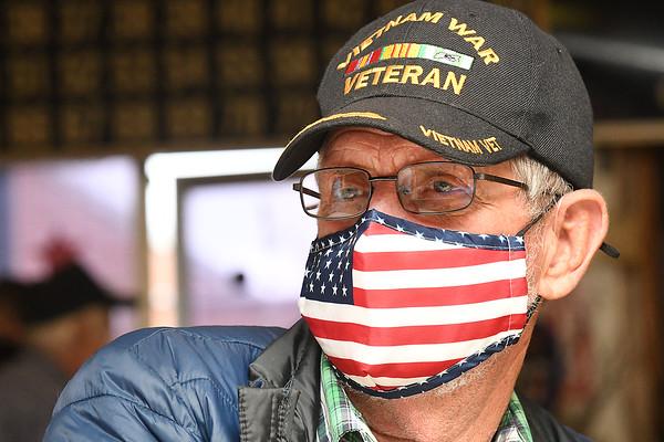 "Wilbert Bragg, Vietnam Veteran, listens to guest speaker Alfred ""Mack"" Skaggs, Lt. Colonel U.S. Army Vietnam veteran, during a brief ceremony held at the American Legion Post 32 on South Kanawha Street.<br /> (Rick Barbero/The Register-Herald)"