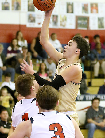(Brad Davis/The Register-Herald) Greenbrier West's Lawson Vaughan puts up a short-range shot as Independence's Josh Perry defends Thursday night in Coal City.