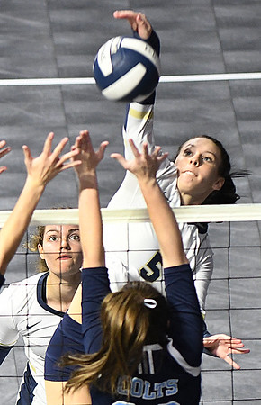Chloe Thompson, of Shady Spring, spikes the ball against Phillips Barbour in the Class AA championship match of the girls volleyball tournament in Charleston Friday even held at the Charleston Civic Center. Shady won the Championship 3-0<br /> (Rick Barbero/The Register-Herald)