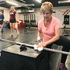 Sue O'Neal, of Beckley, sanitizes the equipment she use after her workout at Redline Fitness in Beckley. Redline was closed down due to COVID-19 and reopened on Monday, May 18.<br /> (Rick Barbero/The Register-Herald)