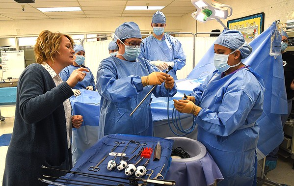 Debi Gibson, instructor of the surgical technology program at ACT working with her students.<br /> (Rick Barbero/The Register-Herald)