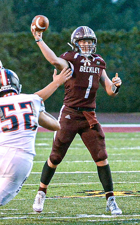 Woodrow Wilson QB Maddex McMillen throws downfield during Friday evening action in Beckley. Photo by F. Brian Ferguson