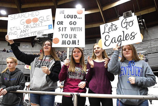 Woodrow Wilson students, Jalene hazelwood, left, Taylor Gunter, Maddy Belcher, Kalyn Belcher and Abby Humphrey, cheer for the girls team against Westside during the second annual New River CTC Invitational held at the Beckley Raleigh County Convention Center. Woodrow won 60-35.<br /> (Rick Barbero/The Register-Herald)