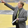 (Brad Davis/The Register-Herald) Greenbrier East head wrestling coach Brian Miluk points to friends and family in the stands after being honored as the WVSSAC and NFHS Coach of the Year for outstanding service and unselfish devotion to interscholastic activities prior to Friday's night session at the 73rd Annual State Wrestling Tournament in Huntington.