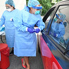 Adriana Gonzalex, medical assistant, left, and Marine Moose, nurse practioner, both with Beckley ARH Hospital, preparing to take COVID-19 testing behind the Southern WV Clincic on Stanaford Road in Beckley. Testing is offered Monday through Friday 10 am to 2 p.m. with no out of pocket expense, just need to bring your insurance and results will be back in 2-3 days. The hospital is currently averaging 100 plus test per day.<br /> (Rick Barbero/The Register-Herald)